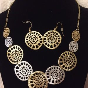 Gold and Silver tone necklace and earrings set.